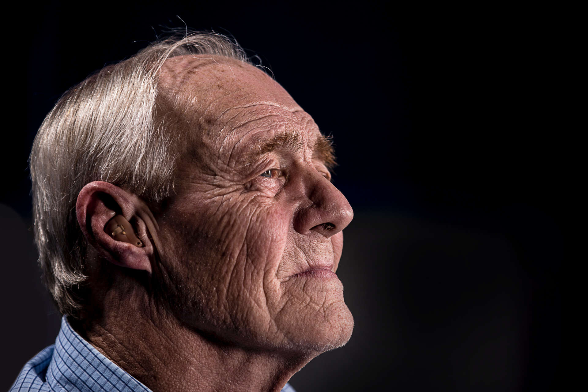 Elderly Man with Hearing Aid